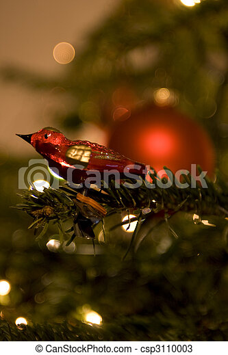 Bird in christmas tree - csp3110003