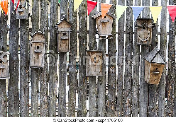 Birdhouses on the fence. - csp44705100