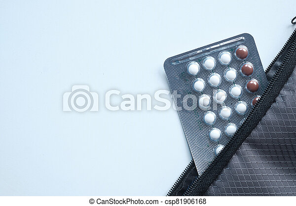 birth control pills on white background, Top view - csp81906168