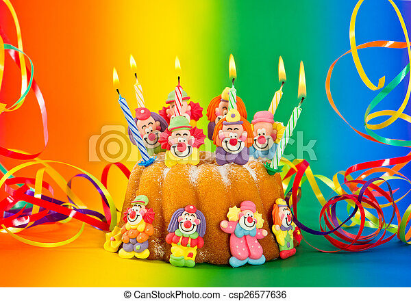birthday cake with candles and streamer - csp26577636