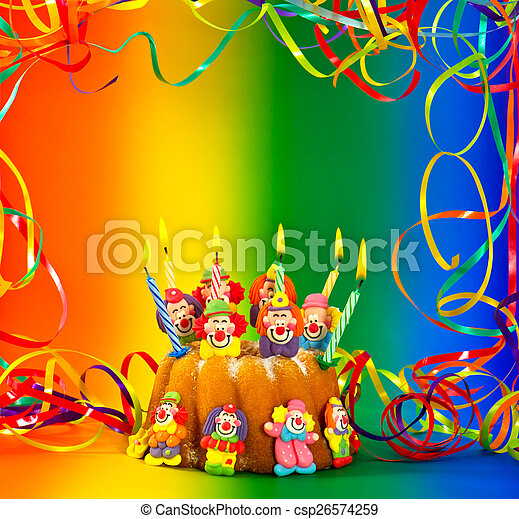 birthday cake with candles and sugar clown decoration - csp26574259