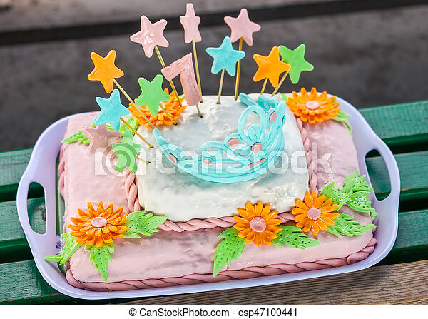 Birthday cake with colorful flowers, stars and diadem