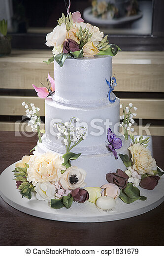 Birthday Cake With Flower And Butterfly On Table