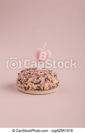 Fine A Small And Colorful Birthday Cake With Heart Shaped Candle On Pink Personalised Birthday Cards Paralily Jamesorg