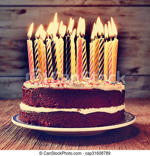 birthday cake with some lit candles, filtered - csp31608789