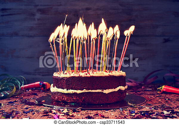 Birthday Cake With Some Lit Candles Filtered