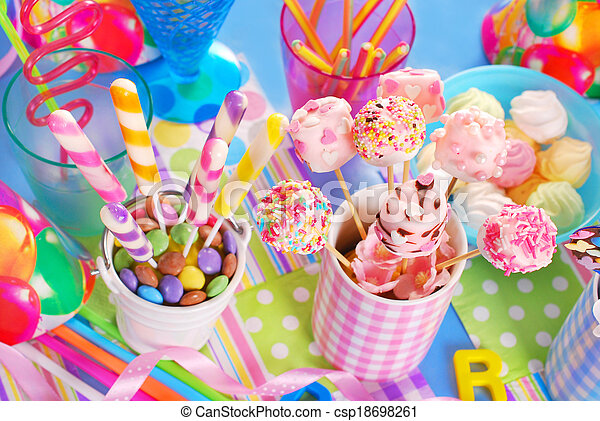 birthday party table with sweets for kids - csp18698261