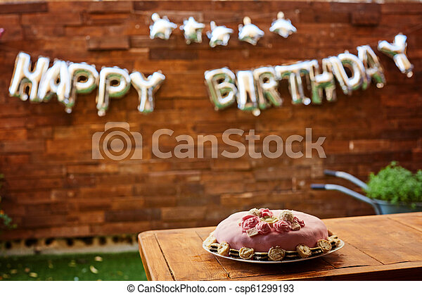 Birthday Party With Pink Cake On A Wooden Background And Inscription Happy