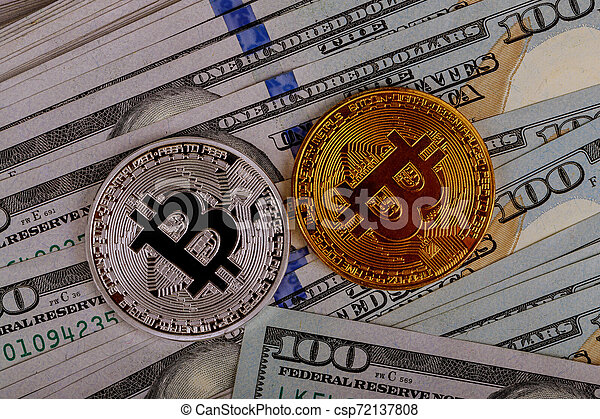 Bitcoin coins on background with US dollars - csp72137808