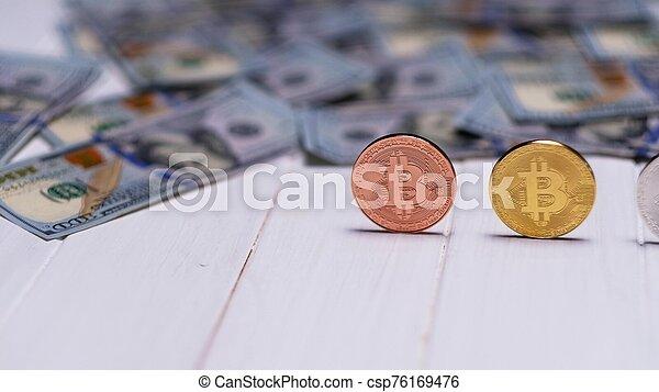 bitcoin coins with dollar bills - csp76169476