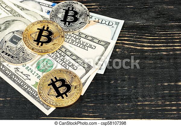 Bitcoin coins with dollars - csp58107398