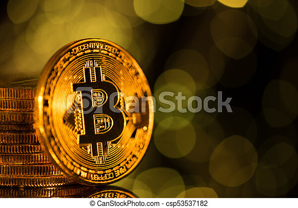 Bitcoin gold coins with defocused abstract background. Virtual cryptocurrency concept. - csp53537182