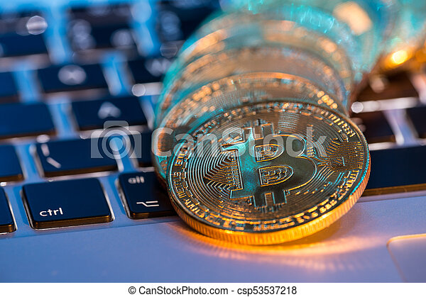 Bitcoin gold coins with laptop keyboard. Virtual cryptocurrency concept. - csp53537218