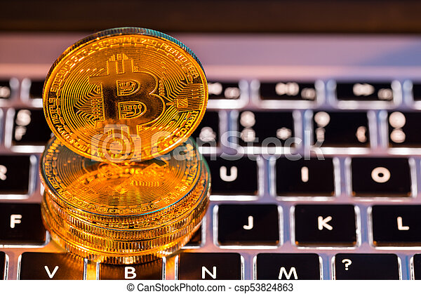 Bitcoin gold coins with laptop keyboard. Virtual cryptocurrency concept. - csp53824863