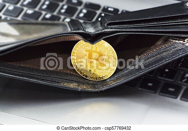 Bitcoin gold coins with wallet, close-up. Virtual cryptocurrency concept. - csp57769432