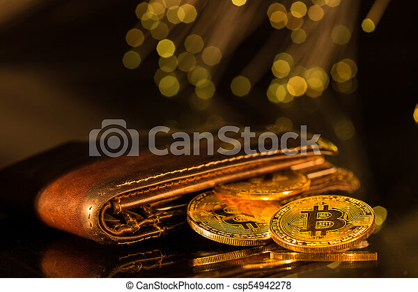 Bitcoin gold coins with wallet. Virtual cryptocurrency concept. - csp54942278