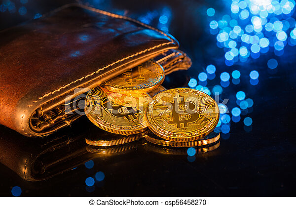 Bitcoin gold coins with wallet. Virtual cryptocurrency concept. - csp56458270