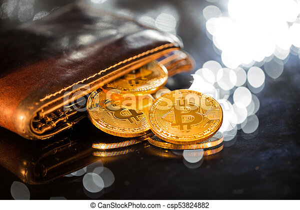 Bitcoin gold coins with wallet. Virtual cryptocurrency concept. - csp53824882