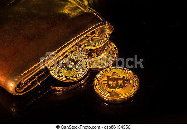 Bitcoin gold coins with wallet. Virtual cryptocurrency concept. - csp86134350