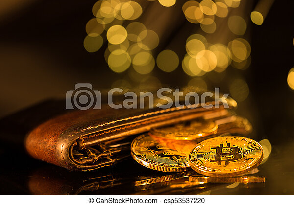 Bitcoin gold coins with wallet. Virtual cryptocurrency concept. - csp53537220
