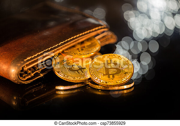 Bitcoin gold coins with wallet. Virtual cryptocurrency concept. - csp73855929
