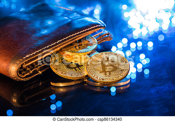 Bitcoin gold coins with wallet. Virtual cryptocurrency concept. - csp86134340