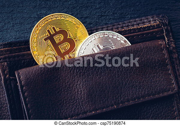 Bitcoin in brown leather wallet. Bitcoin, modern virtual cryptocurrency. Profit from mining crypto currencies. Bitcoin gold coins with wallet, close-up. Virtual cryptocurrency concept. - csp75190874