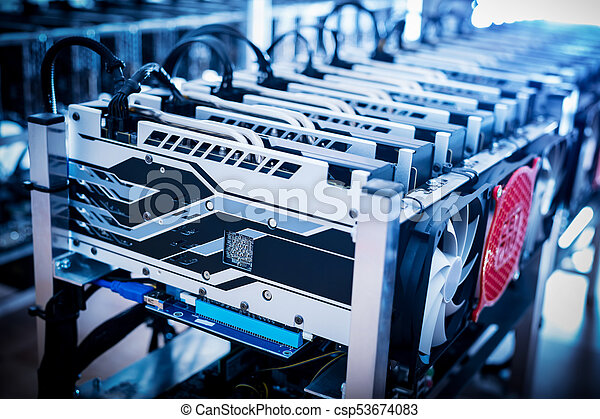 Bitcoin mining devices standing in a row. - csp53674083