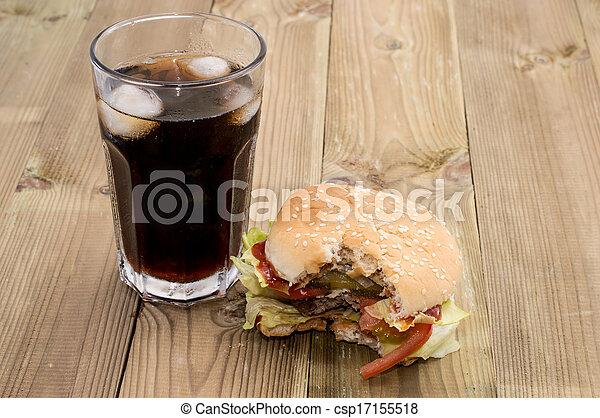Bitten Off Burger with Softdrink - csp17155518