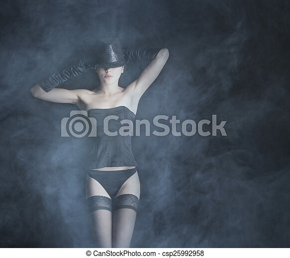 Bizarre lady over black - csp25992958