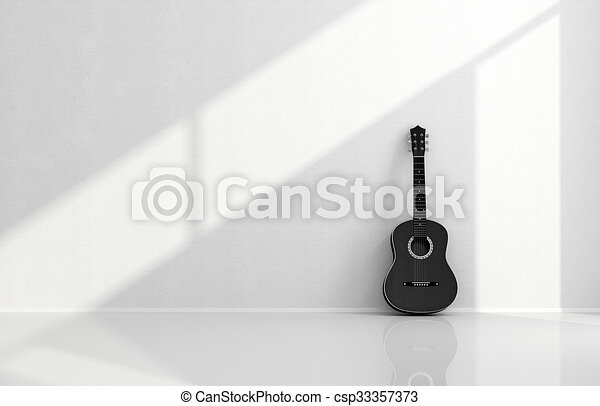 Black acoustic guitar in a white room - csp33357373