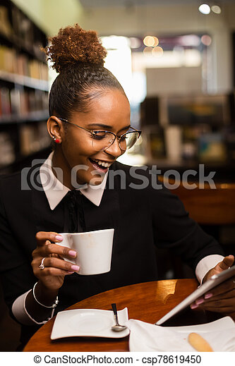 Black african american young yoman drinking coffee - csp78619450