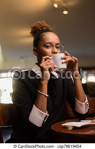 Black african american young yoman drinking coffee - csp78619454