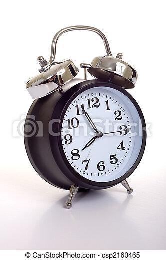 Black Alarm Clock A Black Vintage Looking Alarm Clock On White