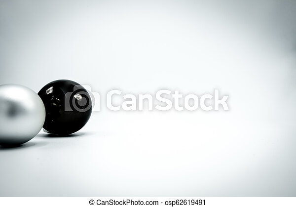 Black and silver Christmas balls on white background. - csp62619491
