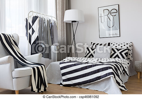 Black and white accents in bedroom - csp46981092
