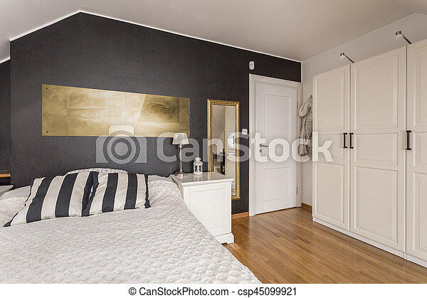 Black and white bedroom with gold accents - csp45099921