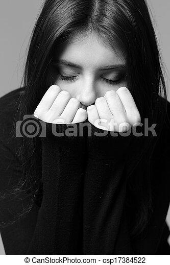 Black and white closeup portrait of a nervous woman - csp17384522