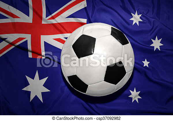 black and white football ball on the national flag of australia - csp37092982