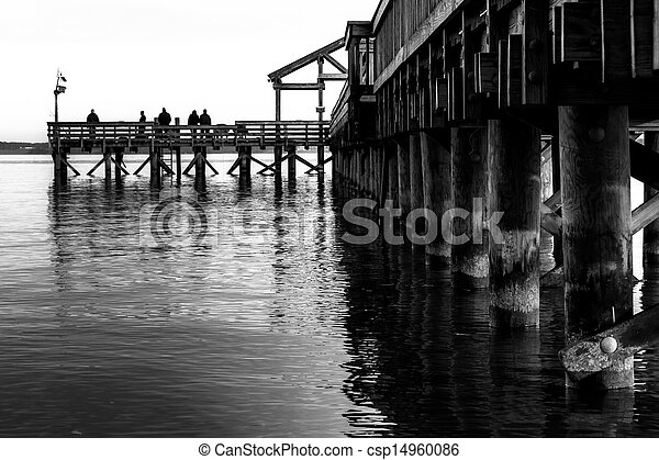 Black and white image of a fishing pier extending into the Potomac River in Leesylvania State Park, Virginia. - csp14960086