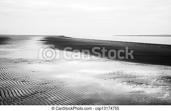 Black and white image of beach at low tide landscape - csp13174755
