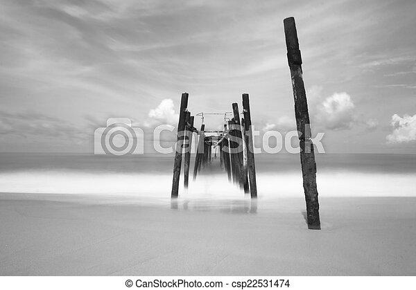 black and white of old bridge to the sea - csp22531474
