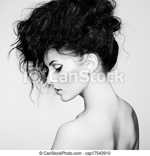 Black and white photo of beautiful woman with magnificent hair  - csp17543910