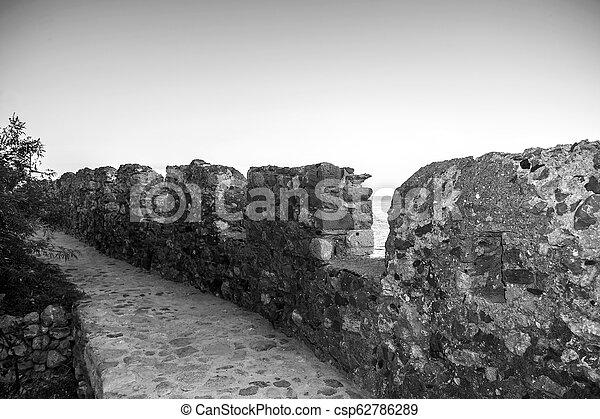 black and white photo of the castle of Monemvasia Greece - csp62786289