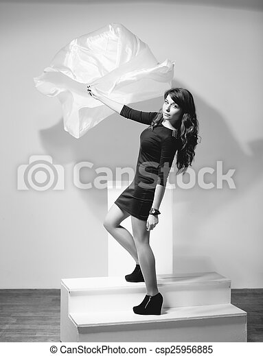 Black And White Photo Of Woman Holding Fabric Blown By Wind