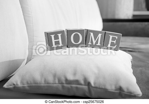 black and white photo of word home spelled on wooden cubes - csp25675026