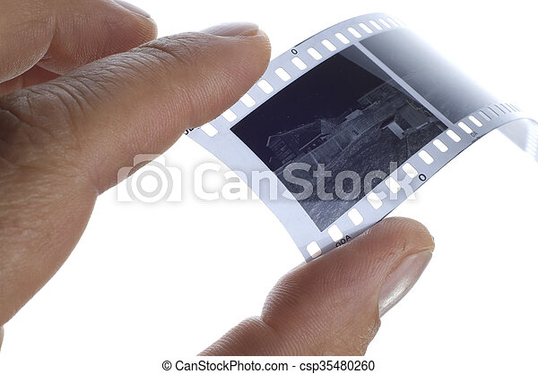 Black and white photographic film in hand - csp35480260