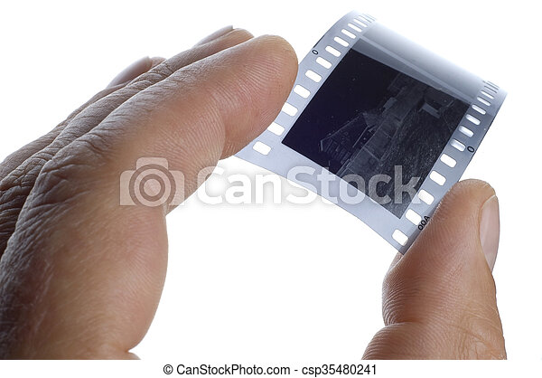 Black and white photographic film in hand - csp35480241