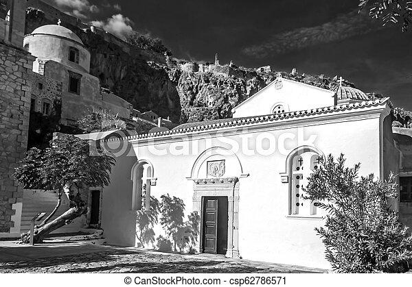 black and white photography of the church of Elkomenos Christos at Monemvasia Greece - csp62786571