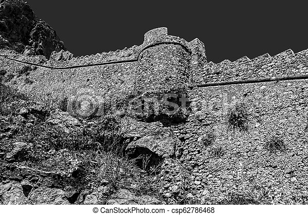 black and white photography of the castle of Monemvasia wall Greece - csp62786468